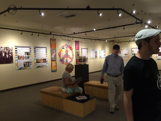 "La Quinta Museum visitors take in the ""By Design 2016"" exhibit on the second floor."