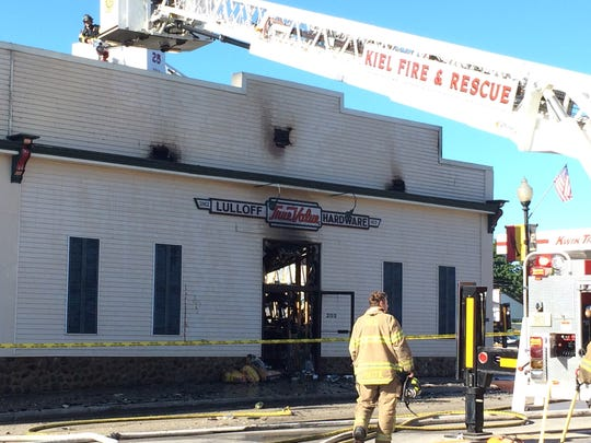 Firefighters and first responders battle a fire at the True Value hardware store in Kiel Monday morning, Aug. 22.