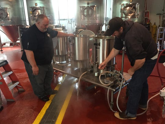 Brewmaster Dean Jones, left, and assistant brewer Ryan