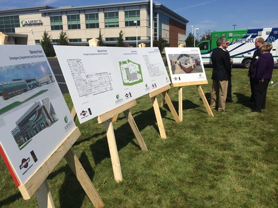Plans for the Aspirus Stevens Point Clinic are on display during a groundbreaking ceremony on Tuesday, Aug. 23, 2016 in the Portage County Business Park.
