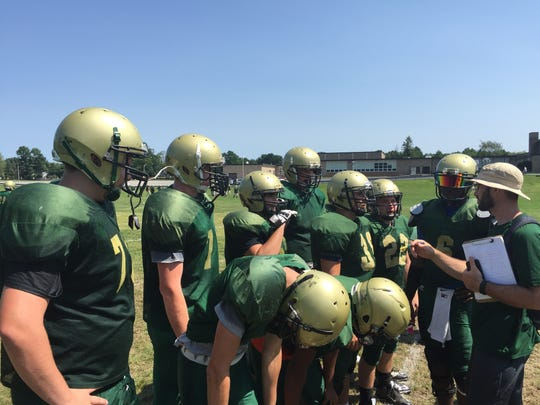 The Franklin D. Roosevelt football team huddles to receive instruction during a practice on Aug. 24, 2016.