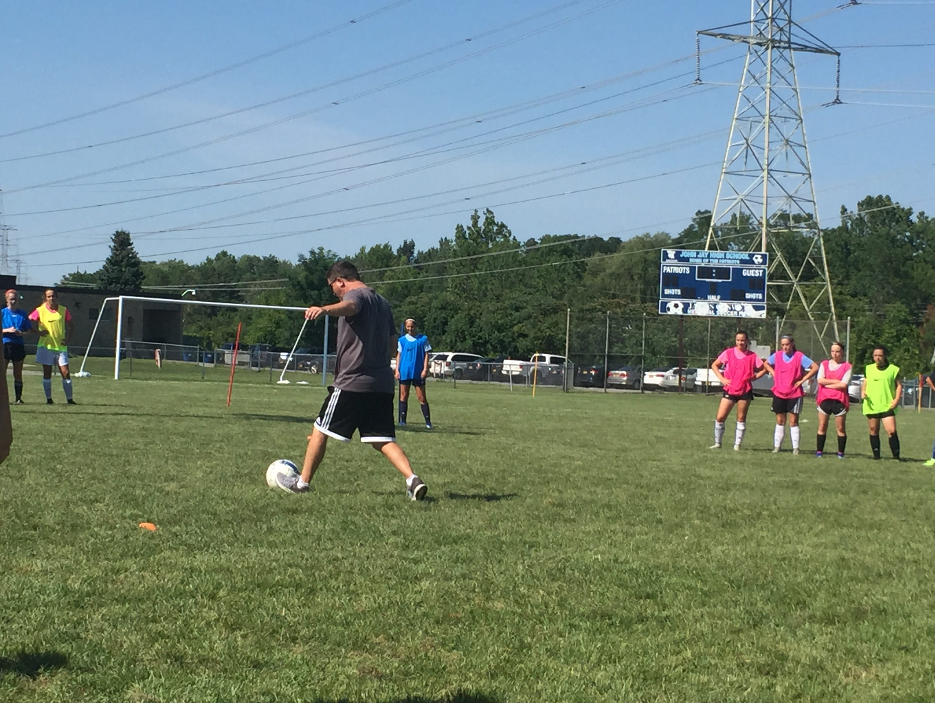 John Jay High School girls soccer coach C.J. Greenwood demonstrates a drill for his team on Wednesday at practice.