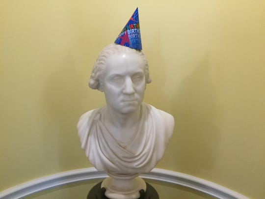 A bust of George Washington sports a birthday hat during a celebration marking the 100th anniversary of the National Park Service on Aug. 25 at the Washington's Headquarters Museum in Morristown.