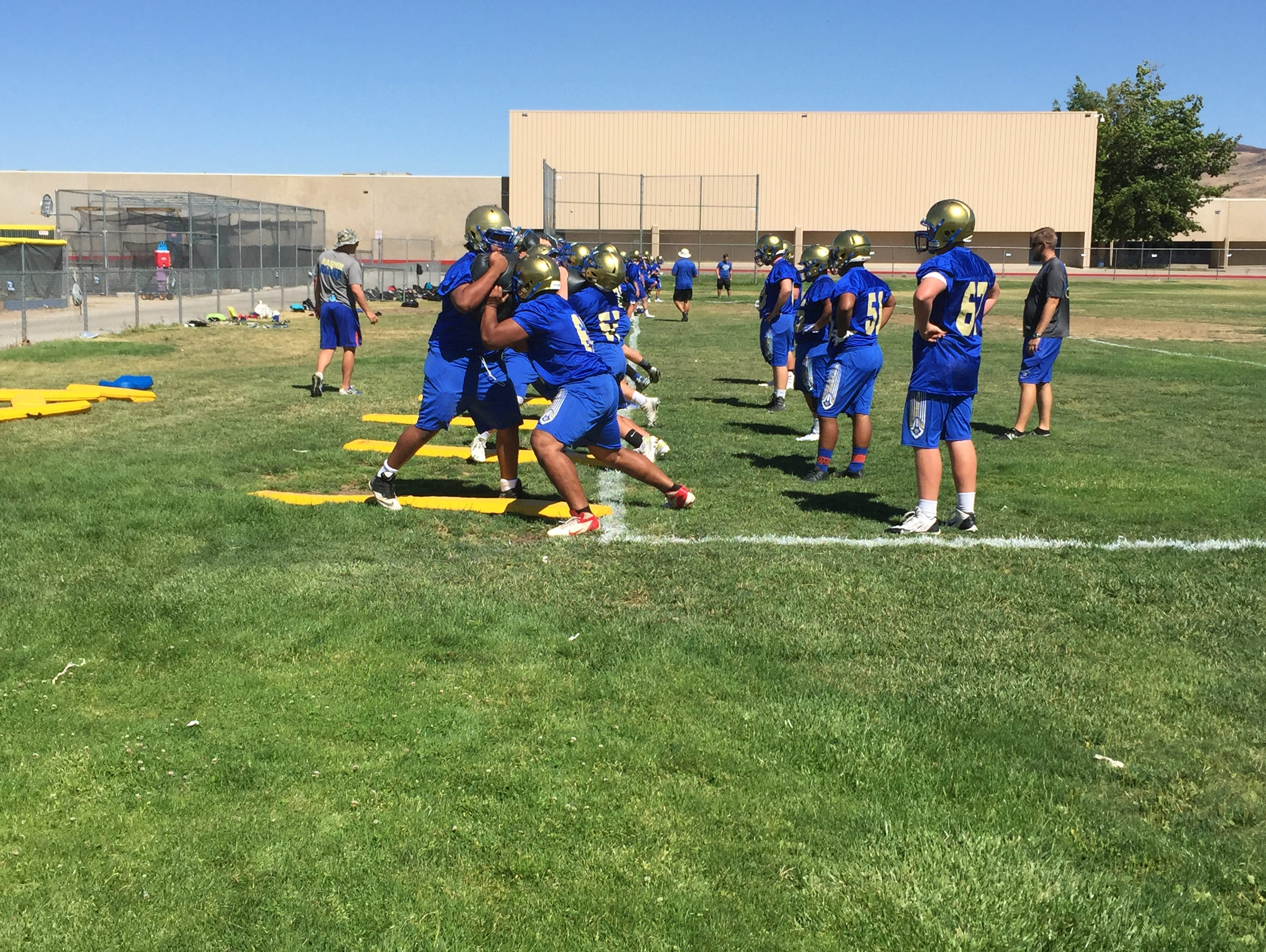 Reed football players practice at the school earlier this month.