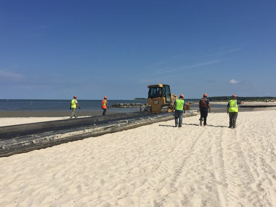 Cottrell Contracting lays pipe for a dredging and beach replenishment project in Cape Charles, Va. The process will take six to ten days.