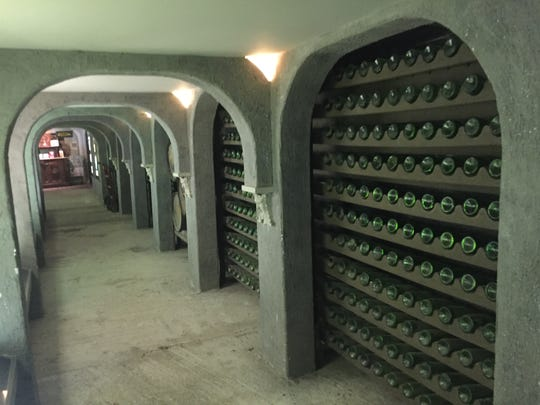 The underground tunnels at Nassau Valley Vineyards are full of empty wine bottles and museum-style displays on the history of wine.