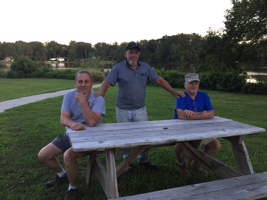 Keith Bauer (center) sits with Earl Yoder (left) and Al Darlin outside the Veterans of Foreign Wars post in Milford. All three support Donald Trump and say his immigration policies should prioritize the interests of people born in the U.S.