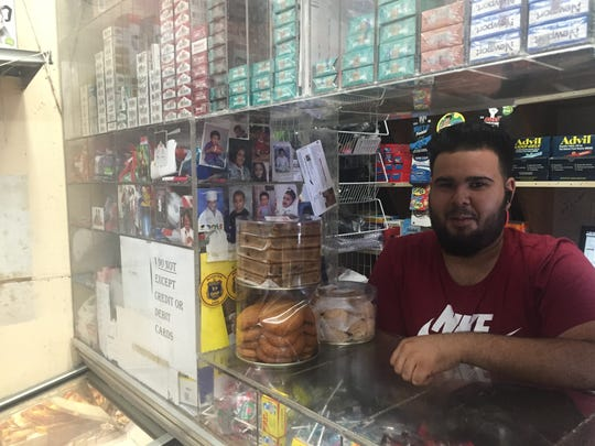 """Elvis Reyes, a Wilmington store clerk, said """"the whole world is against Trump"""" because of the GOP presidential candidate's immigration policies."""