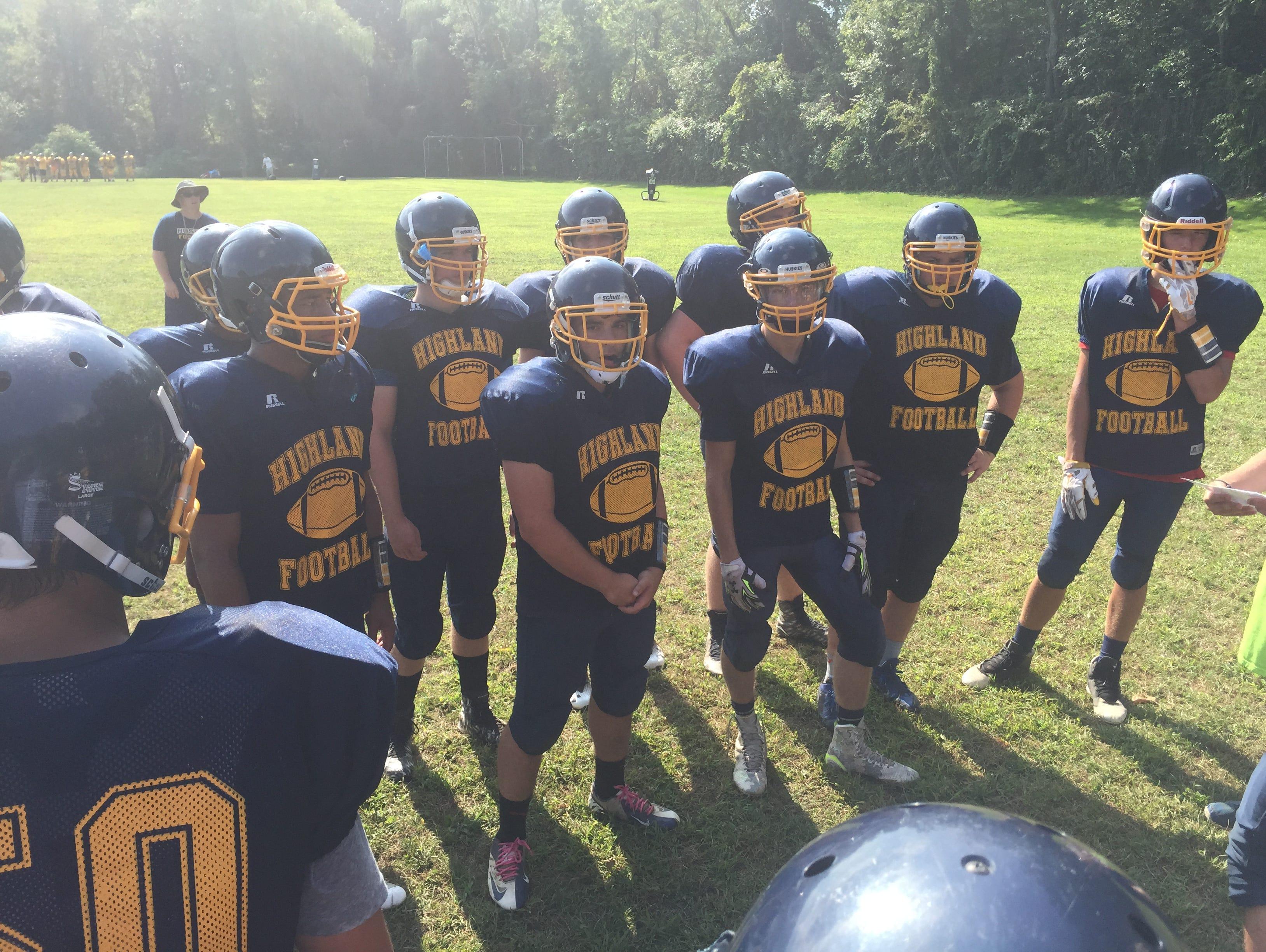 The Highland High School football team huddles during practice on Aug. 26, 2016.