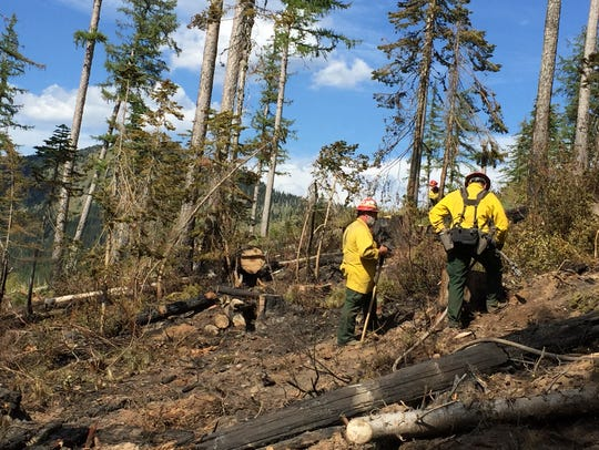 Firefighters from a Maryland crew battle wildfires