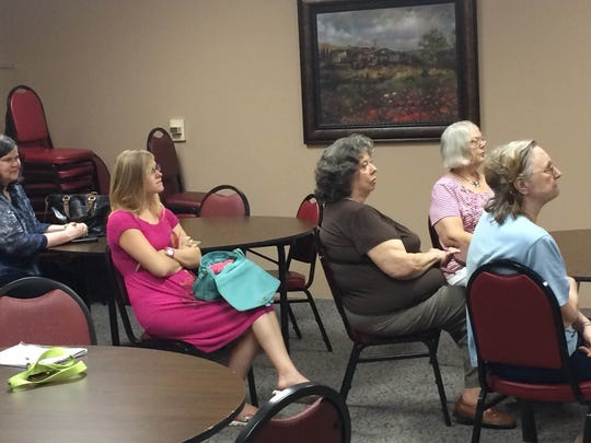 Attendees listen Friday during the senior victimization awareness and prevention session hosted by Tennova Healthcare.