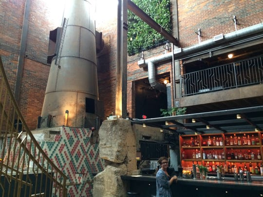 Old Glory is a small bar in a giant space, with live plants clinging to the wall, remnants of the coal-fired boilers and one of the best vibes in town.