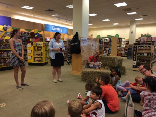 "Center, Nicolle Oppenheimer community business development manager for the Bridgewater Barnes & Noble, welcomes young readers to the start of Saturday's Reading Triathlon celebration at the store. Among the guests was Hayley Pellis, right, with ""Wilbur"" from ""Charlotte's Web."""
