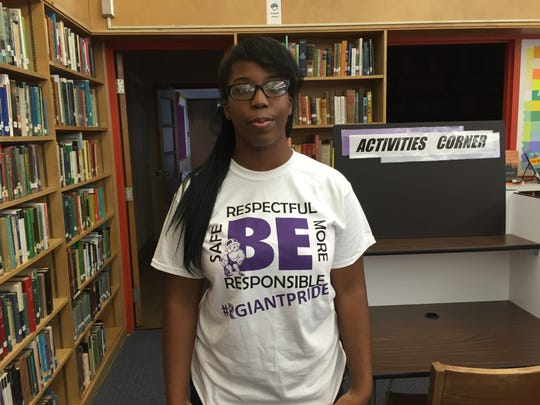 Ross High School Junior Seneca Johnson shows off her new shirt about being respectful while at school. The school's district-wide initiniative, a mandate by the Ohio Department of Education, will promote better communication between students, parents and school staff.