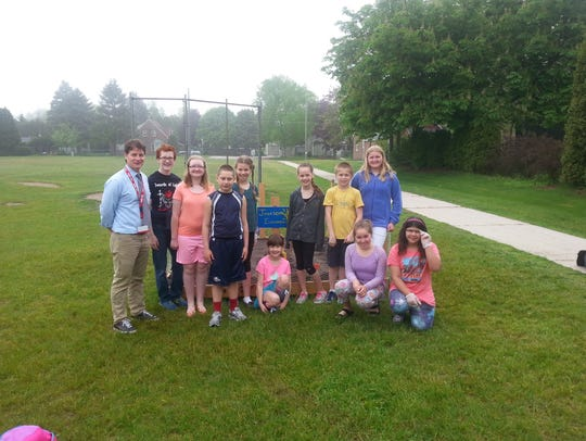 Sixth grade teacher Chris Ausprung (far left) poses