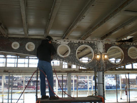 Crews working to restore the interior of the SS Ste. Claire