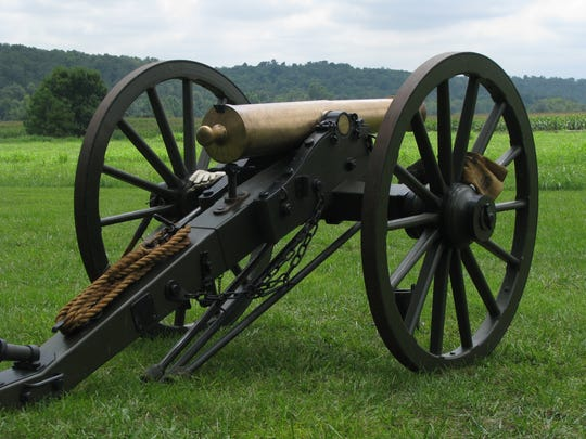 A cannon at Wilson's Creek National Battlefield. In the background is a ridge of land where Union Col. Franz Sigel initially fired upon Southern troops who were in a cornfield.