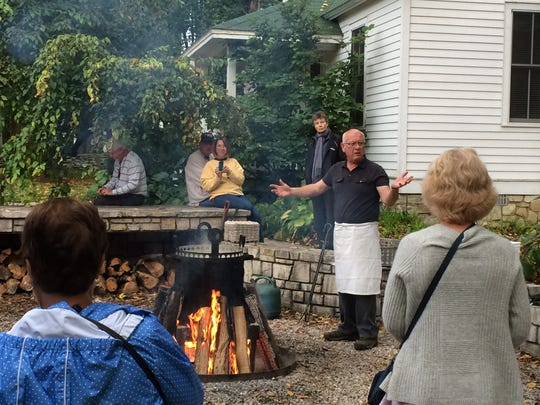 Steve Polster describes the boilover during a fish boil at White Gull Inn in Fish Creek.