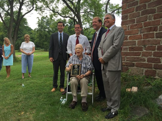 From left to right, top, state Assemblyman Kenneth Zebrowski (D-New City), state Sen. David Carlucci (D-New City), Clarkstown Supervisor George Hoehmann, and Clarkstown Trustee Frank Borelli stand next to Bert Dahm, center, who has spearheaded the effort to restore the town-owned property where Traphagen and Vanderbilt-Budke houses are located.