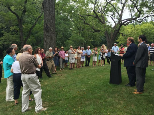 People gather outside the Vanderbilt-Budke house to hear about the securing of two state grants totaling $500,000 that will be used to restore the historic house. Wednesday, Aug. 31, 2016