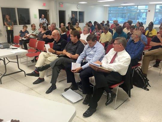 Jeffrey Bross, Rick Berringer, Steven Lewandowski and Mark Dunkle, representatives of Cirrus Delaware LLC, listen to DNREC's Paul Foster talk about a proposed data center for Middletown.