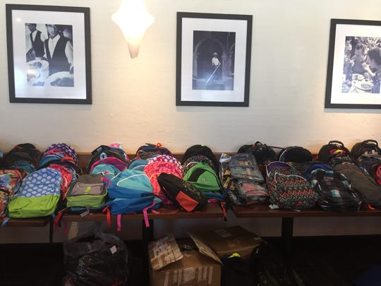 Olive Garden team members from Lafayette and Bossier City donated 250 backpacks for students and families affected by recent floods.