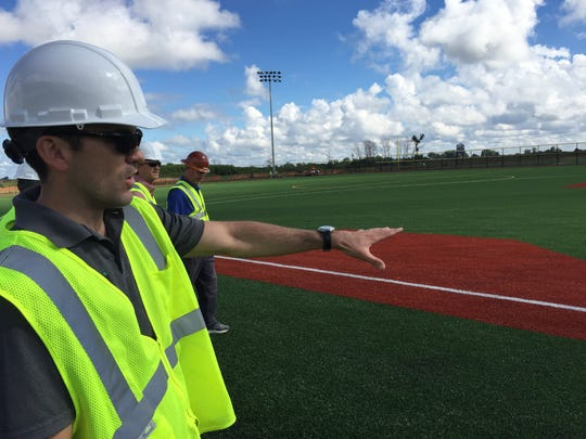 Director of Business for Sports Force Parks Jim Arnold shows what a standard baseball field will look like at the new sports complex in Sandusky. With Cedar Point as a backdrop, the complex will host teams both locally and nationally, with each player receiving a ticket to Cedar Point.