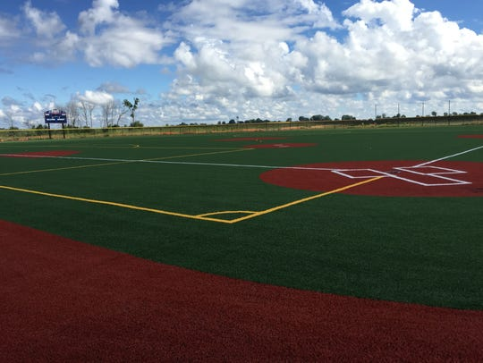 Baseball field with artificial playing surface capable