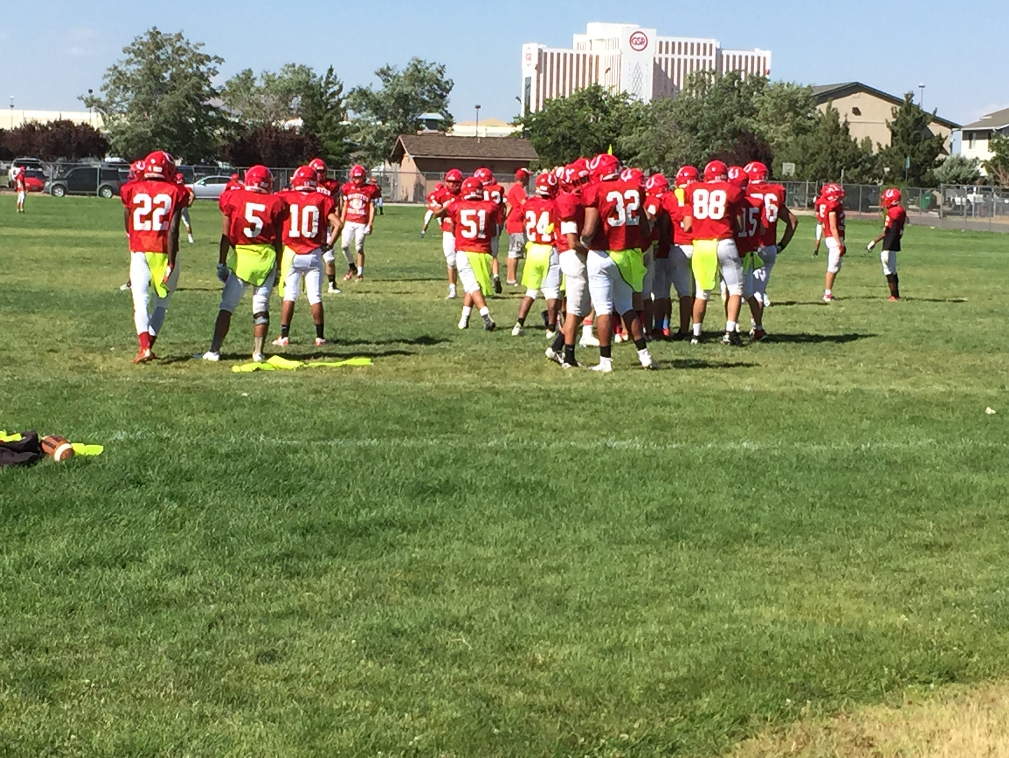 The Wooster football team practices at the school Wednesday.