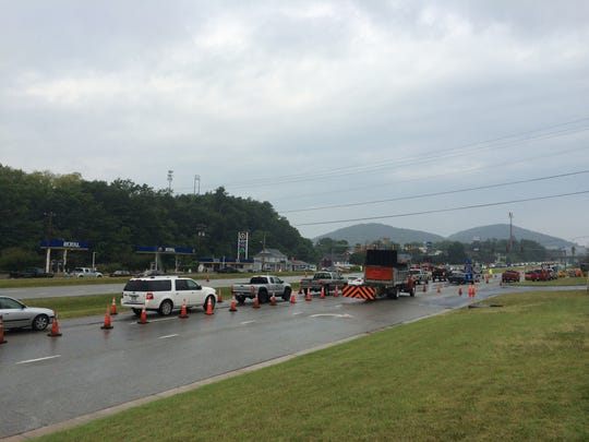 Drivers wait to continue while traffic is stopped on