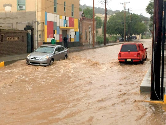 Raging waters coming down Yankie Street in Silver City.