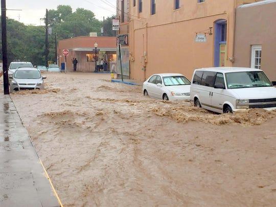 A look at flooded street heading toward Bullard in downtown Silver City.
