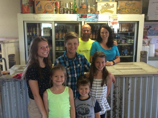 The Wenzels pose inside their family-run This & That Wisconsin Store just outside of Stratford.