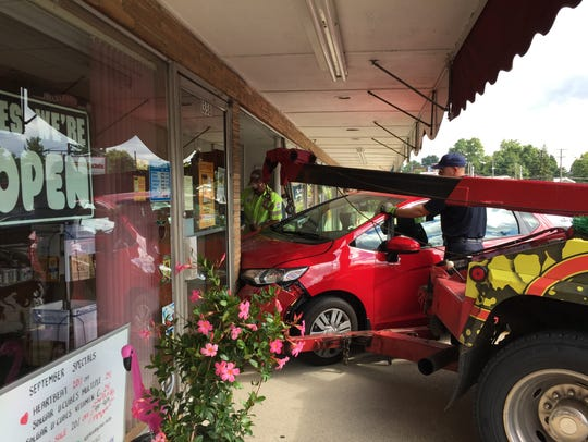 The red Honda that went through the front of Posh Boutique