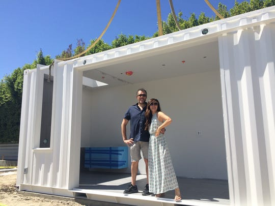John Winter and his fiance Xiao Liu stand inside a shipping container that will become their new pool cabana in Palm Springs.
