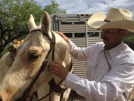 Sid Kahla makes sure all his right with his horse before