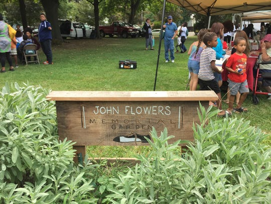 A sign in Poughkeepsie's Mansion Square Park is dedicated