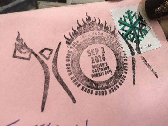 The Black Rock City Post Office postmark is stamped onto one of the letters mailed out from Burning Man.