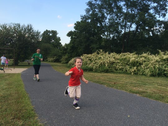 Eleanor Hansen, 5, sprints along the South River Greenway