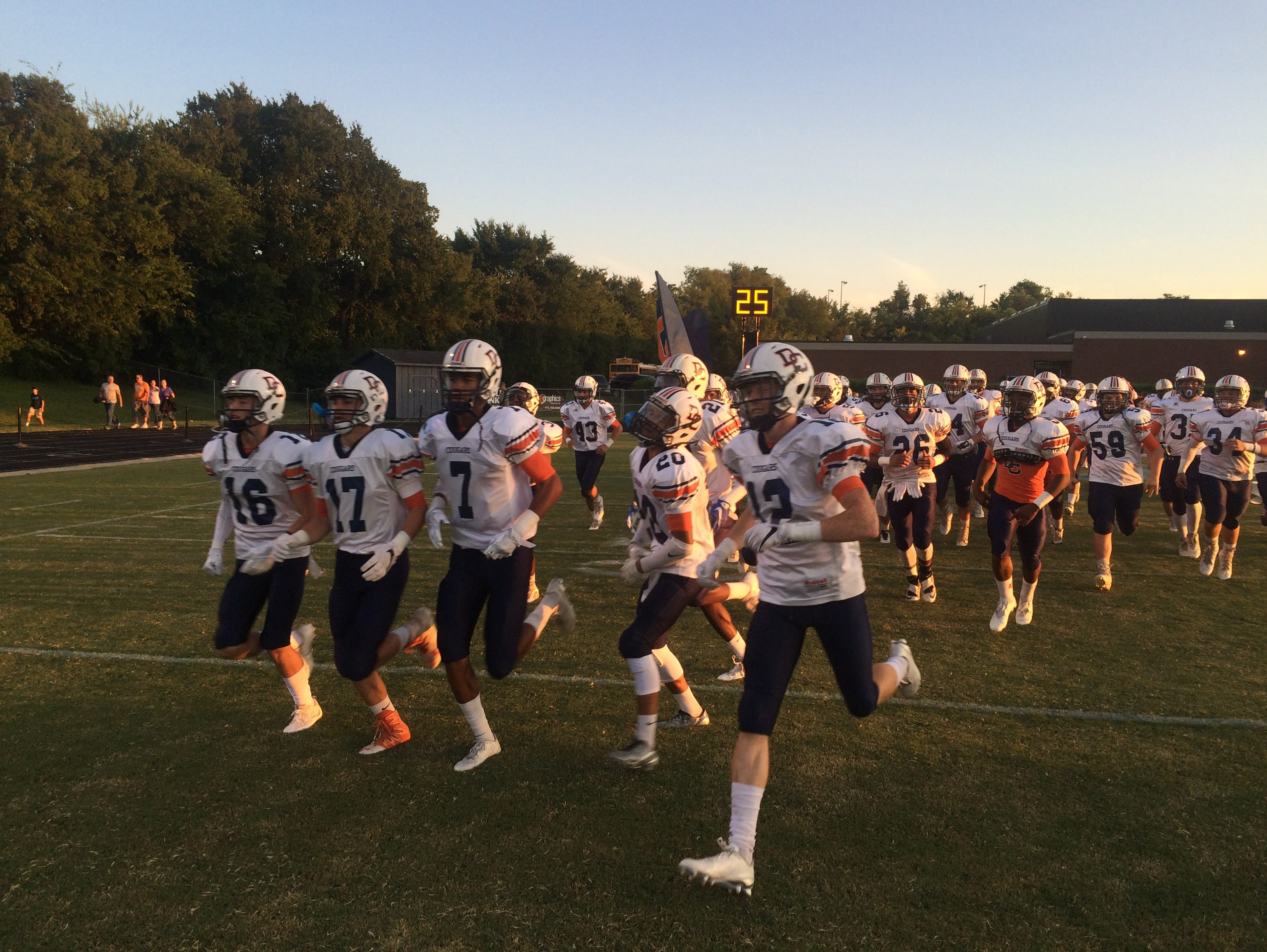 The Cougars race towards the sidelines before their game against Centennial.