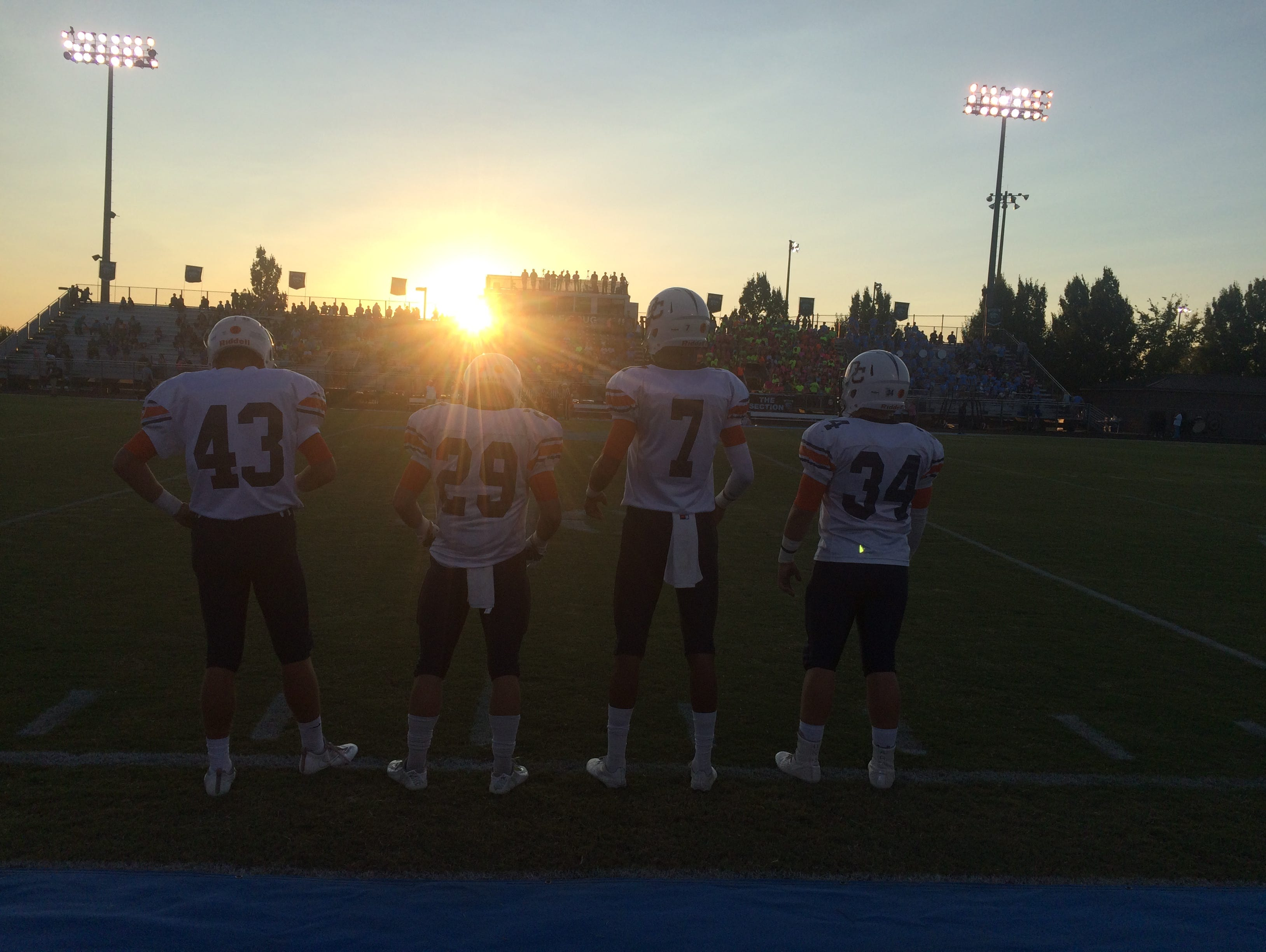 From left, Dickson County captains Austin True, Andrew Stanford, Trey Grimes and Tyler Armstrong await to walk to midfield for the coin toss.