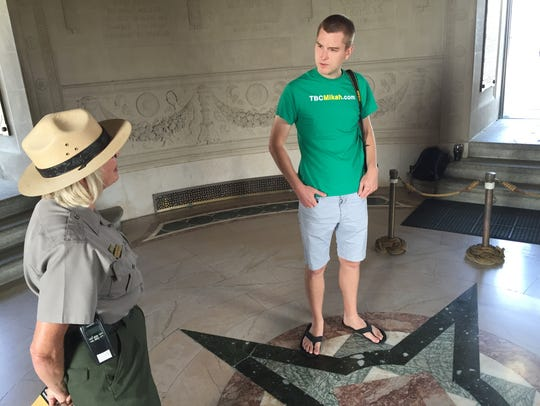 Mikah Meyer stands over burial site of both British