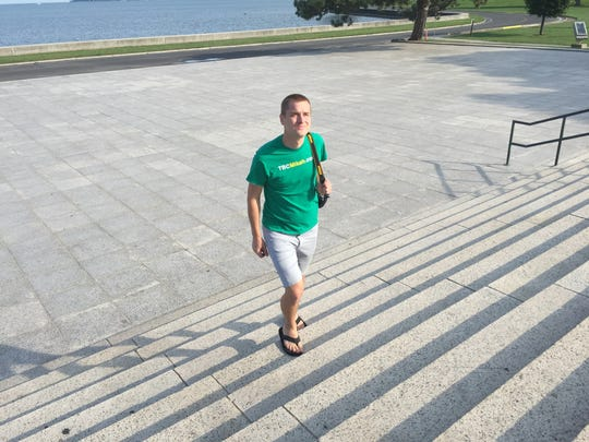 Mikah Meyer walks the steps leading to Perry's Victory in Put-in-Bay. The monument, the third tallest in the national park system, was built to commemorate the Battle of Lake Erie.
