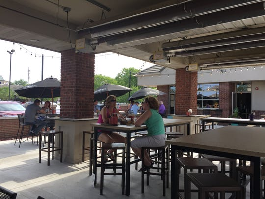 Taco Hangover's patio has its own busy bar and stays