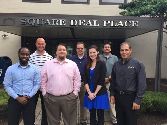 Kevin Blake, right, is the president and a co-owner of ICS. From left, Martin DeWitt, Beau Brinsko, Peter Zayac, Todd Gage, Shana Clark and Vince Passante are new employees.