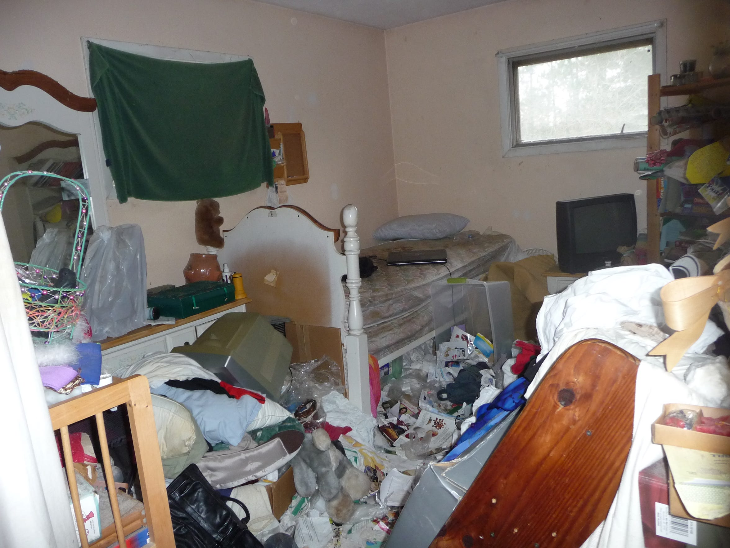 "Compulsive hoarding is defined as an ""obsessive need"