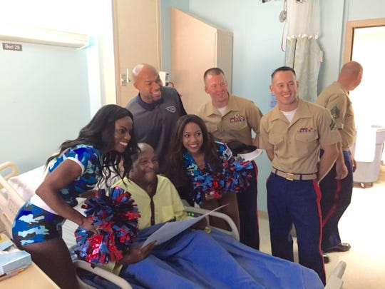 James Rice, 60, is visited by several U.S. Marines, Titans cheerleaders and former Titans player Chris Hope at the VA Hospital in Nashville on Sept. 9. 2016.