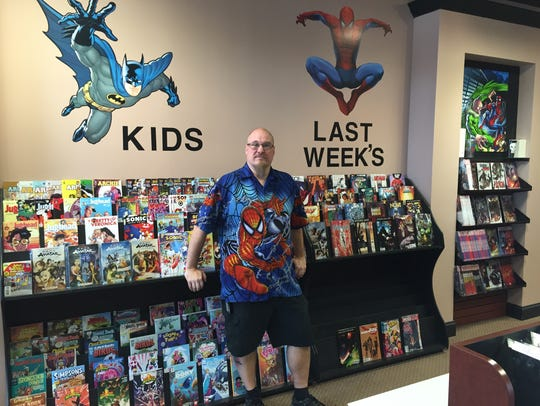 Bill Voigt, manager of Comicmania in Milltown, is shown.