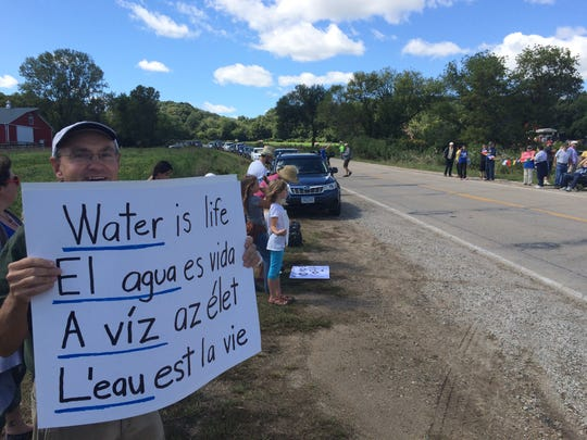 Royce Bitzer of Ames protests the Bakken pipeline on Saturday, Sept. 10, 2016 at a worksite east of Pilot Mound.
