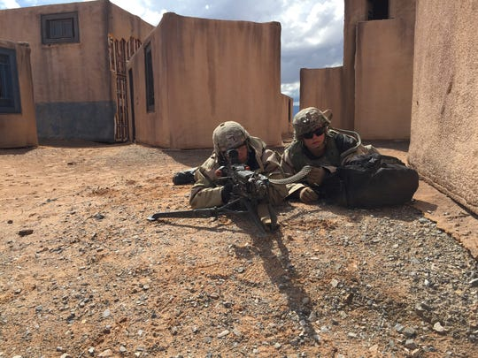 Soldiers from 1-36 Infantry get ready to lay down suppressive